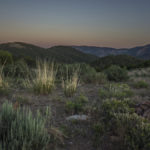 northen monitor range mountains with full moon along basin and range trail