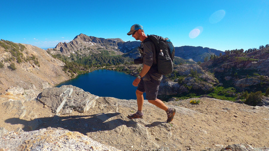 hiker walking the ruby mountains with liberty lake in the background