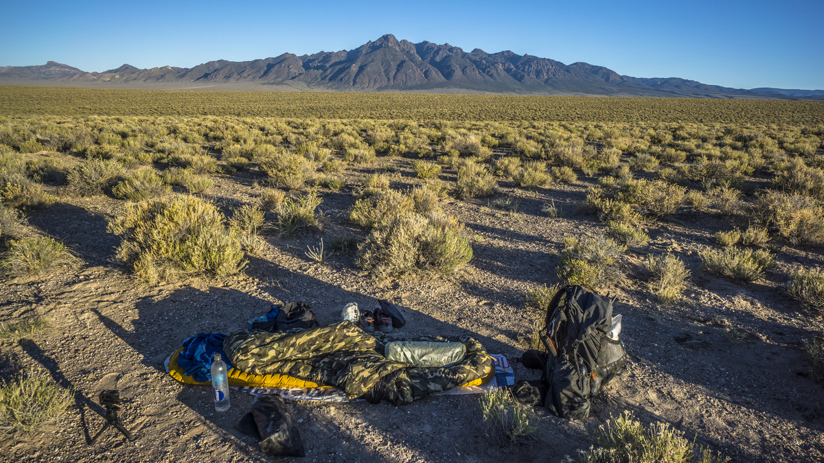 cowboy camping in the desert with morey peak on the horizon